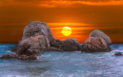 Beautiful colorful sunset over sea and boulders on Sri Lanka Royalty Free Stock Photo