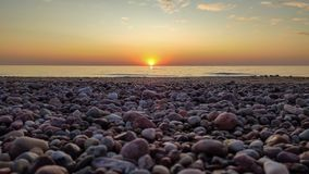 Free Beautiful Colorful Sunset Sunrise Landscape With Sand Beach, Golden Sun And Stones At Baltic Sea Royalty Free Stock Images - 166181789