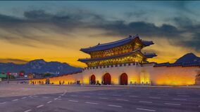 beautiful colorful twilight. of  front gyeongbokgung palace.footage people.standing still.at seoul south korea
