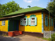 Beautiful colorful ukrainian village house exterior with red porch and green, white windows with shutters. Colorful ukrainian village house exterior with red Stock Photo
