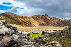 Beautiful colorful volcanic mountains Landmannalaugar and camping site in Iceland, earth formation royalty free stock photos