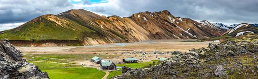 Beautiful colorful volcanic mountains Landmannalaugar and camping site in Iceland, earth formation. Beautiful colorful volcanic mountains Landmannalaugar and royalty free stock photos