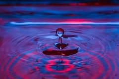 Beautiful colorful water splash from fallen drop Royalty Free Stock Photo