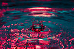Beautiful colorful water splash from fallen drop Royalty Free Stock Image