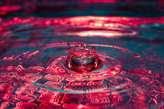 Beautiful colorful water splash from fallen drop Royalty Free Stock Photography