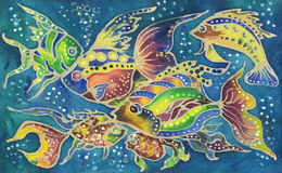 Beautiful colorful watercolor hand painted batik fish on blue textile background. Watercolor batik painting fish on textile background Royalty Free Stock Image