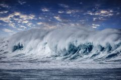 Beautiful and Colorful Wave with a Blue Sky and Clouds in Maui, Hawaii royalty free stock photography