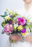 Beautiful colorful wedding bouquet in a hand of a bride Stock Photography