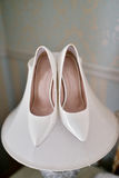 Beautiful colorful wedding shoes for bride indoors Stock Images