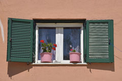 Beautiful colorful windows with flowers in Corfu island, Greece Stock Photos