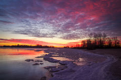 Beautiful colorful winter landscape with frozen lake and sunset Stock Photography