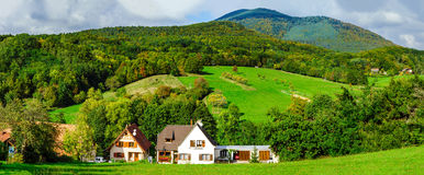 Beautiful colorized autumnal hills and meadows in Alsace Stock Photos
