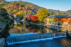 Beautiful colour leaves on the mountain in autumn season with small canal and waterfall at Arashiyama. Beautiful colour leaves on the mountain in autumn season Royalty Free Stock Photos