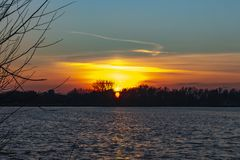 A beautiful coloured sky above lake Zoetermeerse plas in Zoetermeer, Netherlands thanks to the remains of a pearly sky. A beautiful coloured sky above lake royalty free stock image