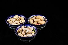 Colourful bright East style plates with different nuts stock photo