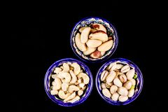 Colourful bright East style plates with different nuts royalty free stock image