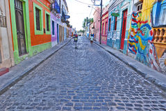 Beautiful colourful houses in Olinda. OLINDA, RECIFE, PRNAMBUCO, Brazil, SEPTEMBER 1, 2009. Beautiful colourful houses in Olinda on both sides of a cobblestone Royalty Free Stock Image
