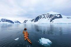 Beautiful colourful kayaks on the blue ocean, Antarctic Peninsula. Antarctica royalty free stock image
