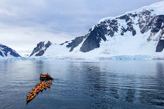 Beautiful colourful kayaks on the blue ocean, Antarctic Peninsula. Antarctica Royalty Free Stock Images