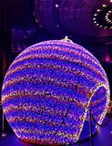 A round Christmas ornament lights up in Macao