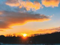 Sunset glowing on the horizon. Beautiful and colourful sunset with horizon in torrington connecticut united states royalty free stock photos