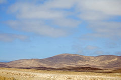 Beautiful colours of the Atacama Desert, Chile. Beautiful colours of the Atacama Desert, with golden sand dunes & blue sky, Northern Chile, South America royalty free stock images