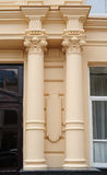 Beautiful columns on the facade of building Stock Photography