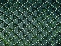 Beautiful combination of wire net and camouflage Stock Photo