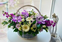 Beautiful combined bouquet in a wicker basket. royalty free stock images