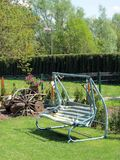 Swing bench in garden, lithuania Stock Image