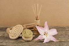 Beautiful composition with aromatic oil and massage brushes on wooden background. Weight loss and body care concept stock image
