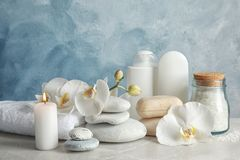 Beautiful composition with candle and spa stones. On light table stock photo