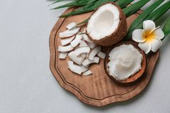 Beautiful composition with coconut oil and nuts. On grey background royalty free stock images