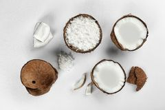 Beautiful composition with coconuts on  background. Beautiful composition with coconuts on white background Royalty Free Stock Photography
