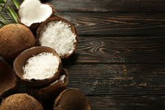 Beautiful composition with coconuts on  background. Beautiful composition with coconuts on wooden background Stock Photography