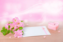 Beautiful composition of delicate pink rose, heart shaped candle Stock Photography