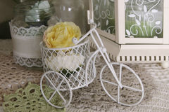 Beautiful composition with flowers and decorative bicycle. Composition with decorative bicycle, with flowers and candles Royalty Free Stock Image