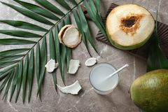 Beautiful composition with fresh green coconuts. And glass of milk on table, top view Stock Images