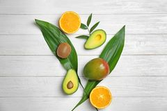 Beautiful composition with fresh tropical fruits. On wooden background royalty free stock photos