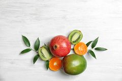 Beautiful composition with fresh tropical fruits. On wooden background royalty free stock image