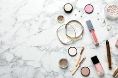Beautiful composition with lipsticks and bijouterie on marble background, flat lay. Space for text stock photos