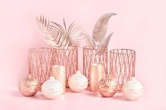 Free Beautiful Composition Of Round Candles, Ceramic And Metal Candlesticks, Palm Leaves In Rose Gold On A Pink Background. Trendy Home Stock Photography - 163602322
