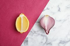 Beautiful composition with ripe red onion. And lemon on color background Stock Photo