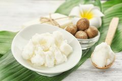 Beautiful composition with shea butter, soap and nuts. On wooden table stock images