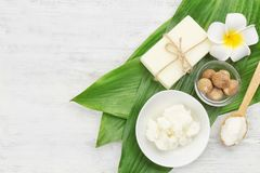 Beautiful composition with shea butter, soap and nuts. On wooden table royalty free stock images