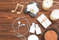 Beautiful composition of spa accessories. And musical notes on brown wooden background Royalty Free Stock Photos