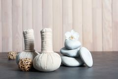 Beautiful composition with spa stones and compress stamps. On table stock photography