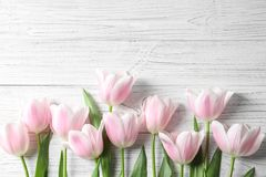 Beautiful composition with tulips for Mother`s Day. On wooden background Stock Photo