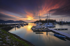 Beautiful composition view of Malaysian Harbour with a yatch during sunset. Stock Photography