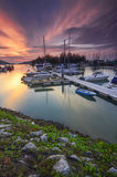 Beautiful composition view of Malaysian Harbour with a yatch during sunset. Stock Photos